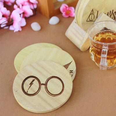 Harry Potter Coasters - Wooden Coaster Set With Holder. These wooden coasters are the best Harry Potter merchandise to own. Looking for Harry Potter gifts? These table coasters are the perfect gifts for harry potter fans.