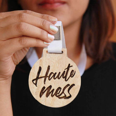 Haute Mess Wooden Medal. This Wooden Medal Comes Engraved On Mahogany Wood or Birch Wood. These Funny Medals And Trophies Make The Best Gift Ideas for Friends