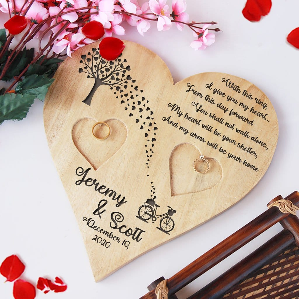 Wooden Heart Shaped Ring Holder Engraved With A Love Quote: With this ring, I give you my heart...From this day forward, You shall not walk alone. My heart will be your shelter, And my arms will be your home. This Personalised Ring Tray Is Engraved With Couple Names & Wedding Date. This engagement ring tray is one of the best engagement gifts for couples and wedding gifts.