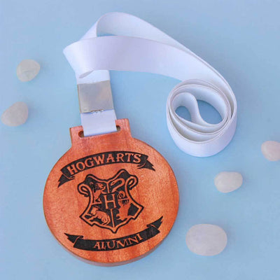 Hogwarts Alumni Engraved Medal With Ribbon. These award medals make the perfect best gifts for Harry Potter fans. Buy unique Harry Potter gifts online from The Woodgeek Store