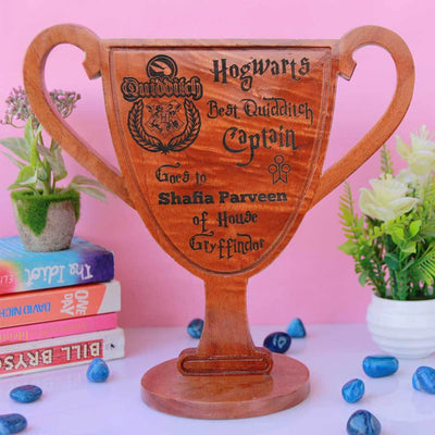 Hogwarts Best Quidditch Captain Wooden Award & Trophy Cup. This Is One Of The Best Personalized Harry Potter Gifts for Potterheads. These Harry Potter Gifts will make great birthday gift ideas for friends.