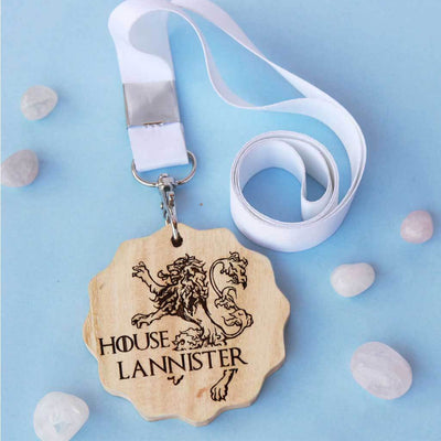 House Lannister Engraved Medal. A unique award that makes great gifts for game of thrones fans. Buy House Lannister sigil engraved custom medals online from The Woodgeek Store.