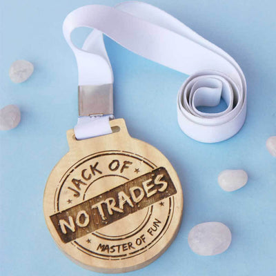 Jack of No Trade, Master Of Fun Wooden Medal With Ribbon. This funny medal will make a funny award for a coworker or a funny gift for a friend.