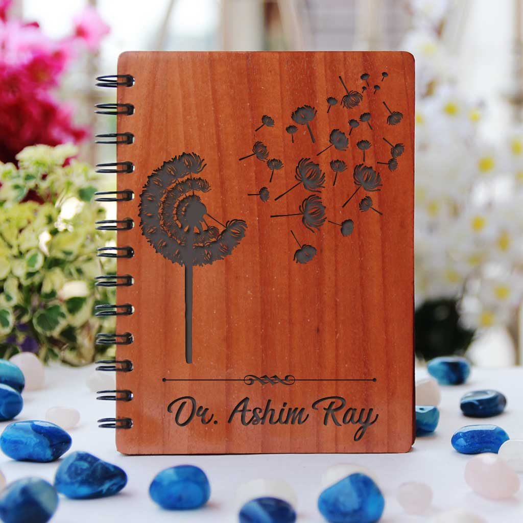 A Minimalist Wooden Notebook Engraved With Dandelion & Personalized With Doctors Name. Looking For Thank You Gifts For Doctors, Retirement Gifts For Doctors Or Graduation Gifts For Doctors? This Spiral Notebook Is The Best Gifts For Doctors.