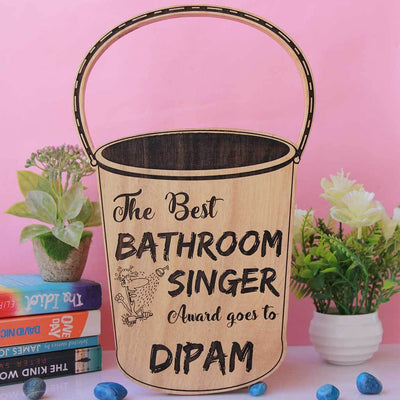 The Best Bathroom Singer Bucket Trophy. These trophies and awards makes funny gifts for friends. Gift this funny award to the bathroom singer in your life. This wooden trophy can be custom engraved with a name.