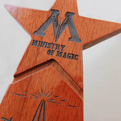The Wizarding Wonder Star Trophy Awarded by The Ministry of Magic to the biggest Harry Potter fan. This is one of the best gifts for Harry Potter fans. Custom Trophies and awards are great personalized Harry Potter gifts for Potterheads.