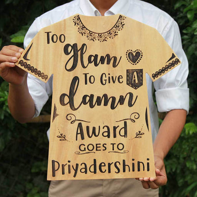 Too Glam To Give A Damn Wooden Award Plaque In The Shape Of a T-shirt. This Personalized Wooden Plaque Makes The Best Gift For Fashionistas. Looking For Friendship day gifts, gifts for friends or gifts for sister? This funny award make unique gifts. This Is also A great gift for fashion bloggers.