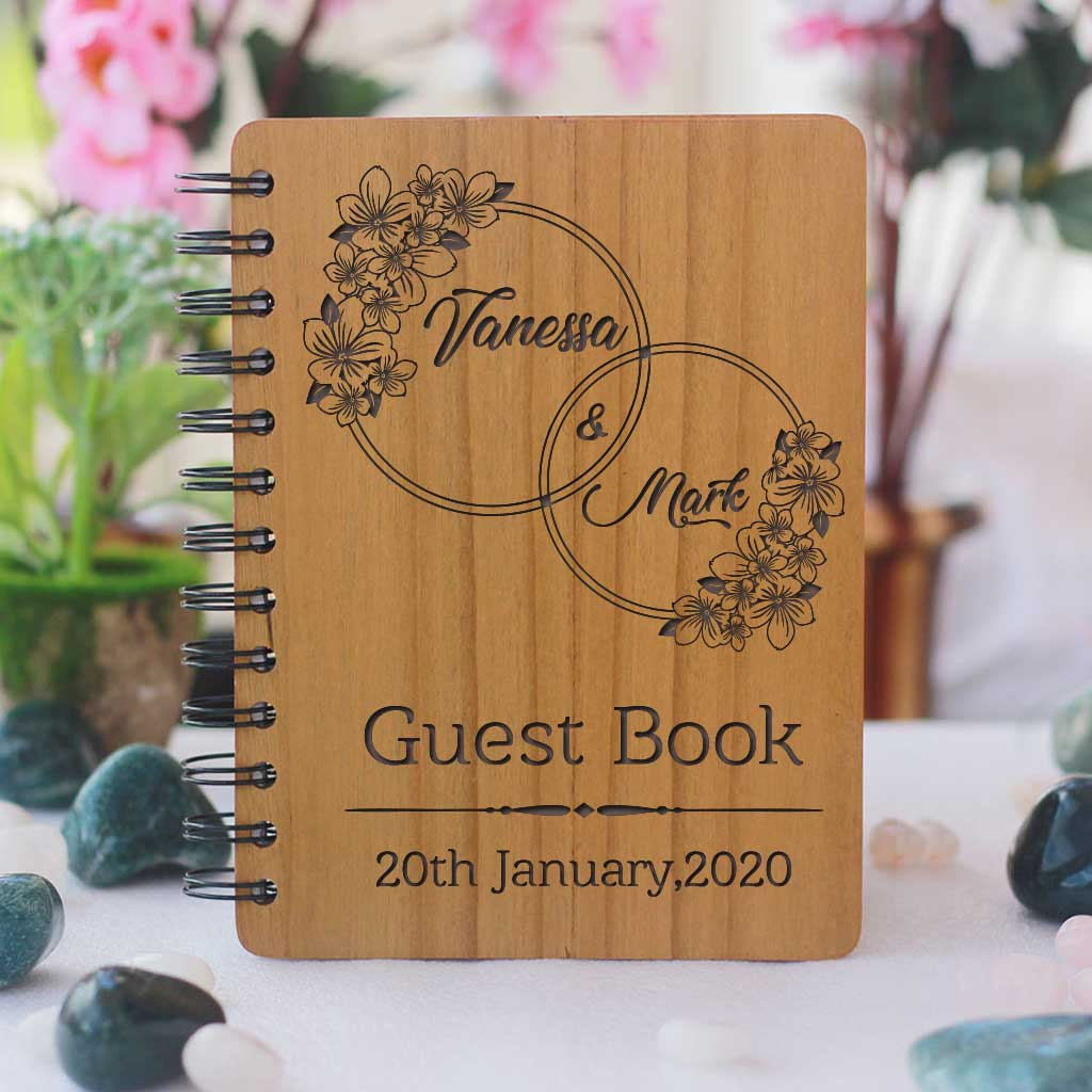 A personalised wedding guest book engraved with names and wedding date. This wood bound notebook makes a great wedding guest book. This is the best wedding journal.