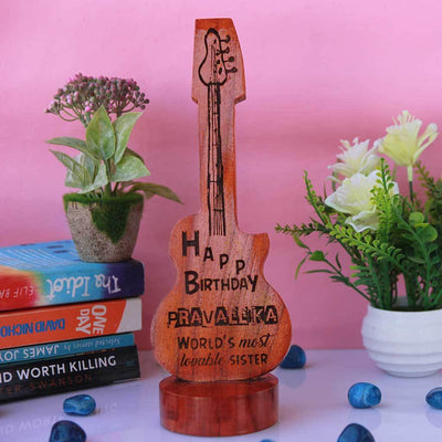 Happy Birthday To The World's Most Lovable Sister Custom Wooden Plaque.  This Personalized Plaque Comes In The Shape Of A Guitar. This Wooden Stand makes Unique Gifts For Sisters. Shop More Personalized Birthday Gifts For Sisters Online From The Woodgeek Store.