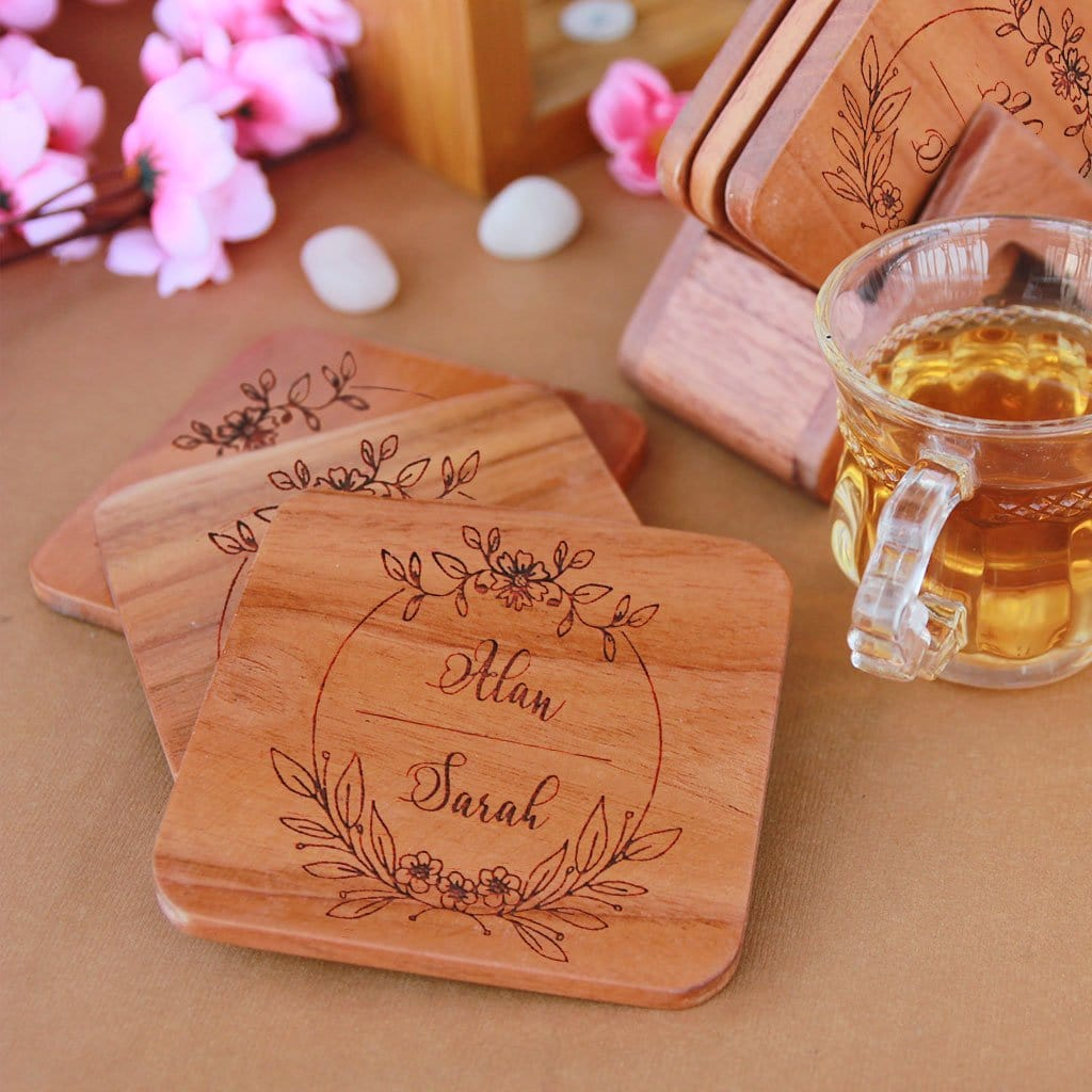 Custom Coasters Engraved With Couple Name - Wooden Coaster Set With Holder. Looking for couple gifts or housewarming gifts? This tea coaster set make unique gifts for couples. These wooden coasters also make great wedding gifts for couples and gift for newly married couple.