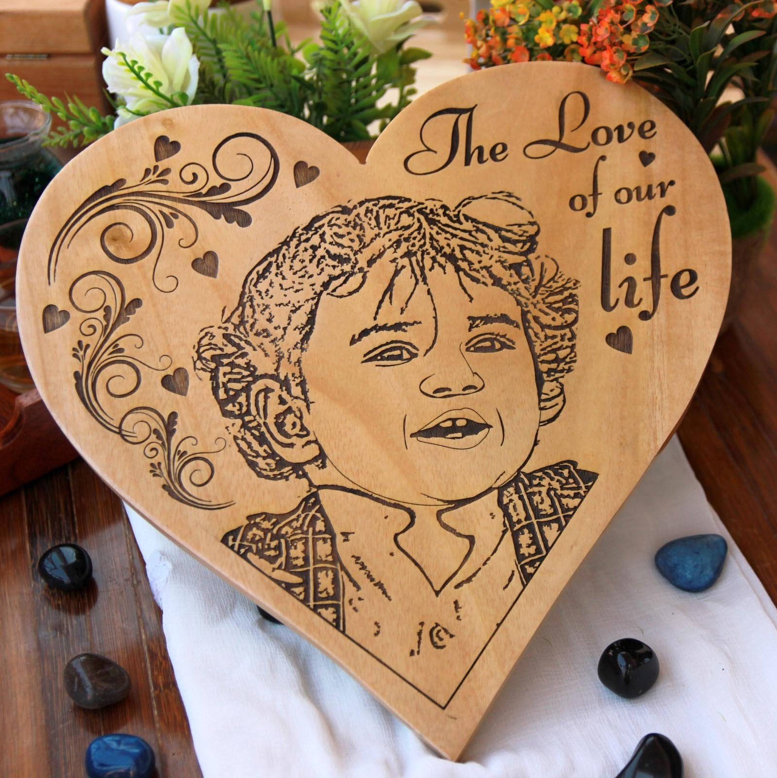Love Of Our Life Wood Engraved Photo. This Heart-Shaped Wooden Photo Frame Engarved With baby Photo is one of the best gifts for new parents. This photo on wood is one of the most sentimental gifts for new parents.