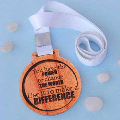 You Have The Power To Change The World. Use It To Make A Difference Wooden Medal - An Inspirational Gift For Employees and Colleagues. This Custom Medal Is Also The Best Inspirational Gift For A Loved One.  Buy More Unique Engraved Gifts Online From The Woodgeek Store.