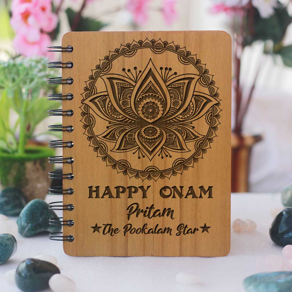 Happy Onam Wooden Notebook Engraved With Pookalam. This Spiral Notebook Makes The Best Onam Gifts. This Personalised Gift Can be engraved with onam wishes in malayalam.