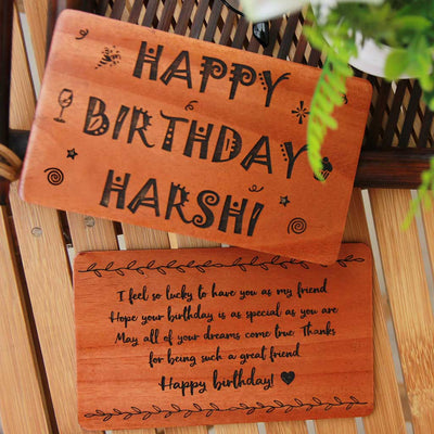 wooden greetings card with happy birthday message engraved on it