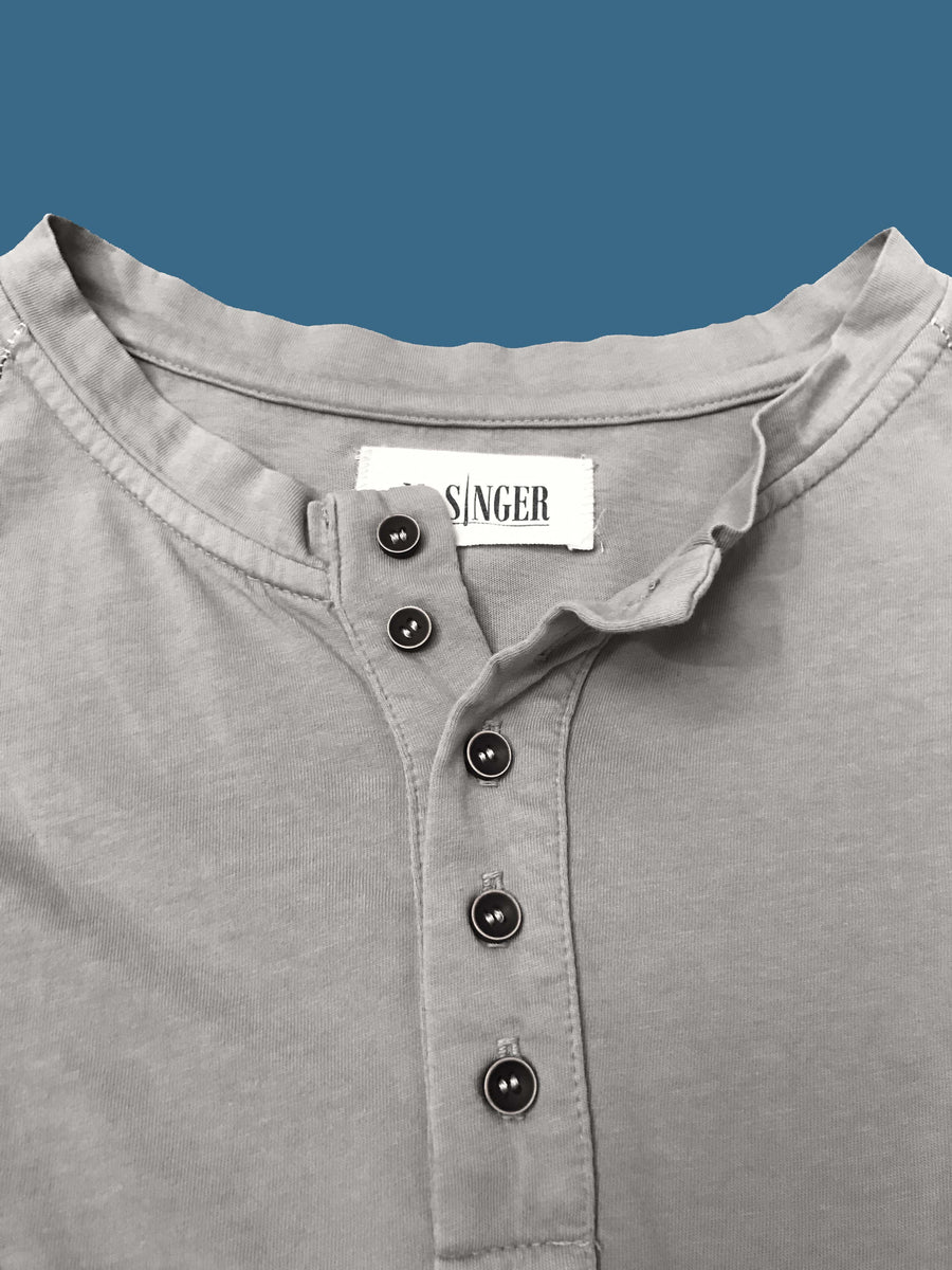 5 button close up on heather grey short sleeve henley