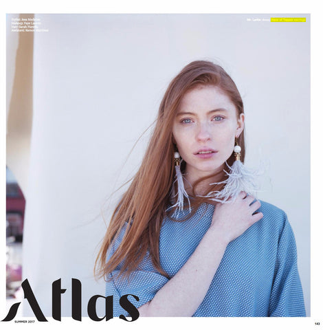 Grey Feather earrings in Atlas Magazine