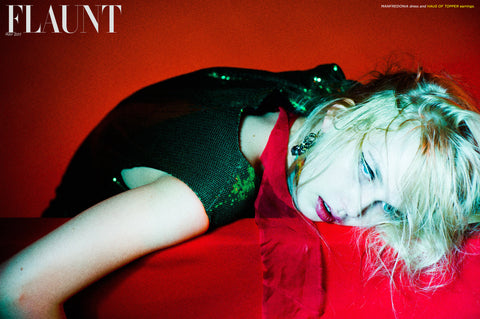 Haus of Topper tassel earrings in Flaunt Magazine
