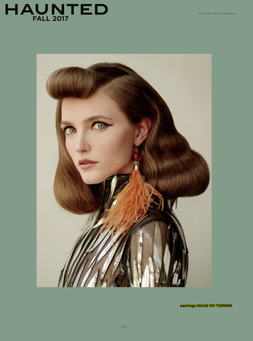 Haus of Topper burnt orange feather earrings in Haunted magazine
