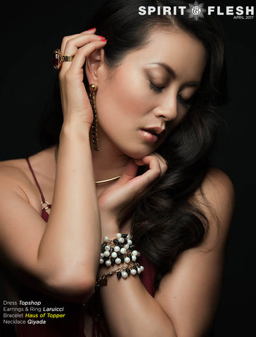 Actress Olivia Cheng wearing Haus of Topper pearl and pyramid necklace as bracelet.