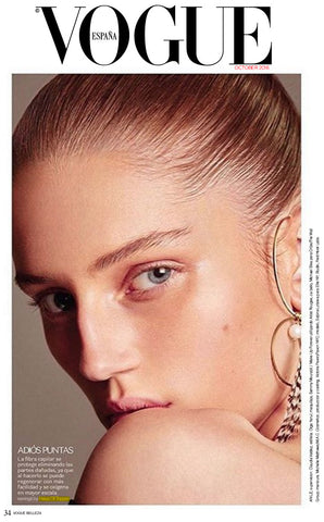 Haus of Topper feather earring in Vogue Mexico