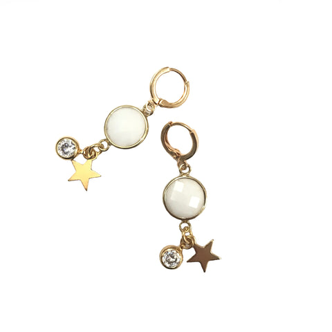 white crystal earring in gold with star motif and crystal