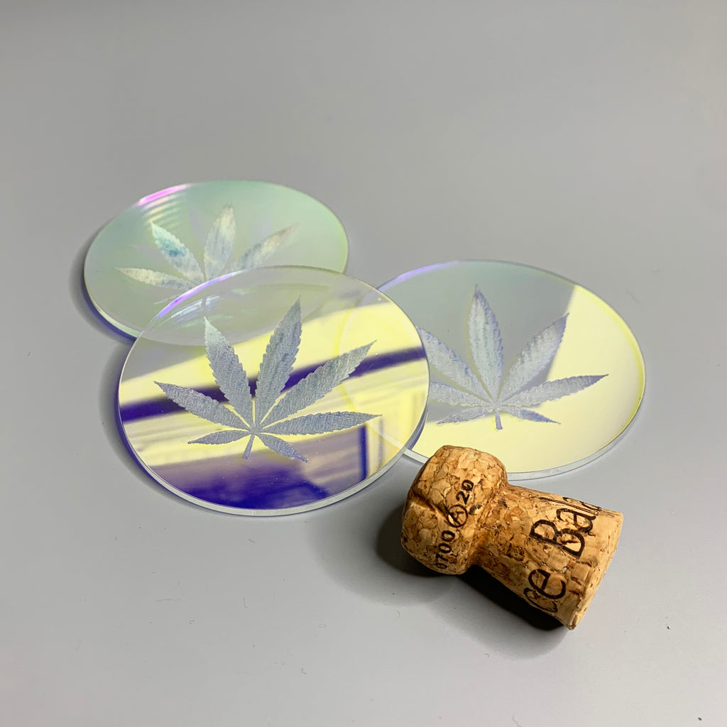 Iridescent acrylic drink coaster engraved with a pot leaf