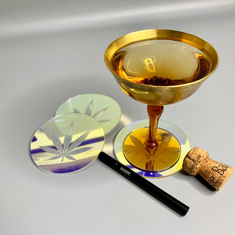 Iridescent acrylic cocktail coaster engraved with cannabis leaf