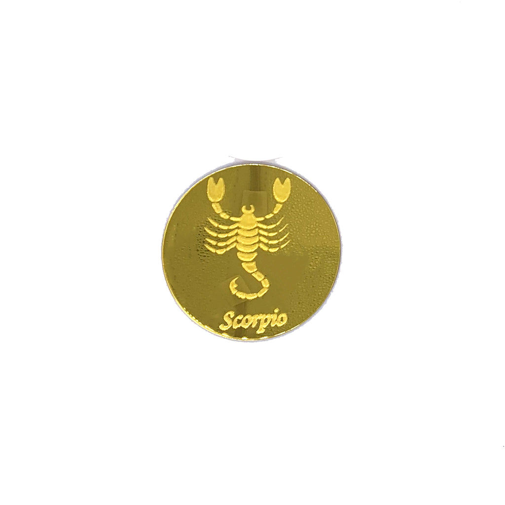 Round, gold mirrored acrylic drink coasters engraved with the scorpion astrology symbol