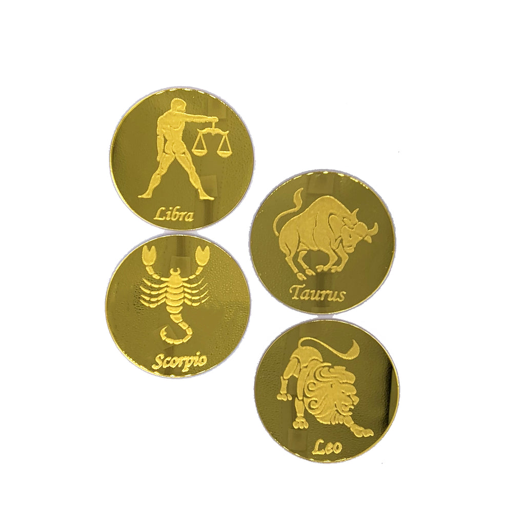 Round, gold mirrored acrylic drink coasters engraved with the zodiac signs