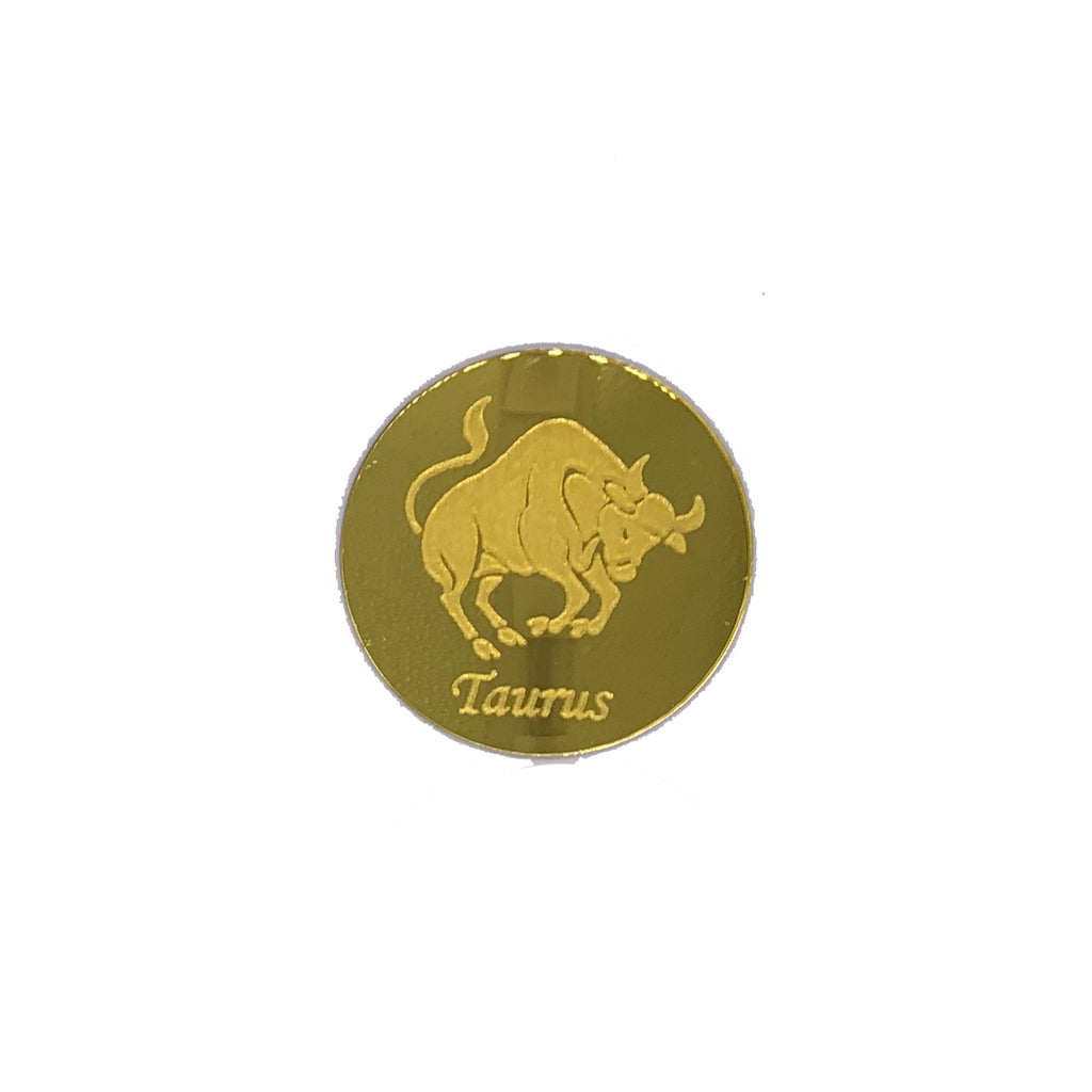 Round, gold mirrored acrylic drink coasters engraved with the Taurus astrology symbol