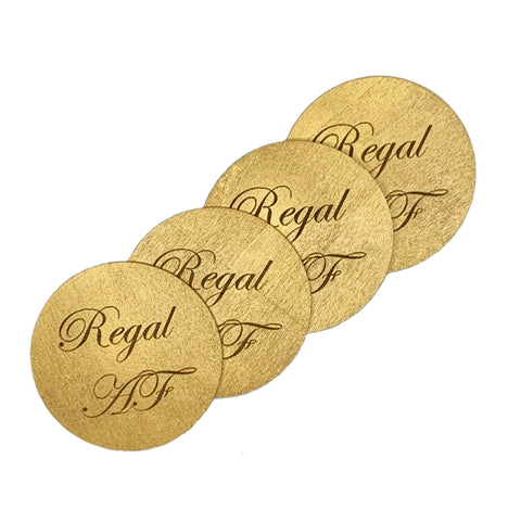 Round wood drink coasters coated in metallic enamel engraved with Regal AF