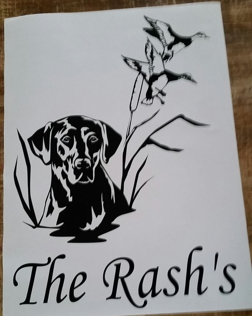 Shipping out Labrador cornhole decals with custom text.