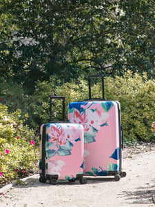 2-pcs CALPAK floral print luggage set: carry on and large suitcase