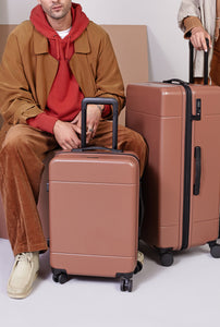 CALPAK Hue hard shell carry-on luggage and Hue Medium suitcase with spinner wheels in brown hazel color