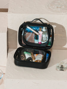 CALPAK mini clear cosmetics case with black handles