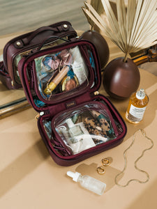 CALPAK transparent cosmetics case with zippered compartments in burgundy