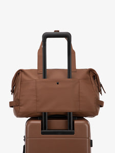 brown hazel CALPAK Hue duffel bag with luggage trolley sleeve