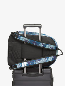 CALPAK blue Glenroe backpack attached to carry on suitcase