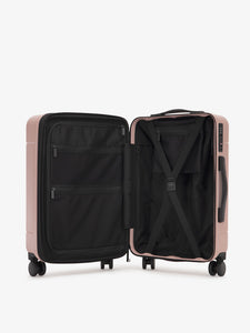 pink CALPAK Hue hardside carry on suitcase with laptop compartment and compression straps