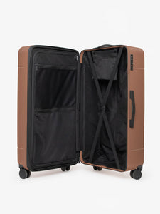 CALPAK Hue trunk suitcase in brown hazel color with compression straps