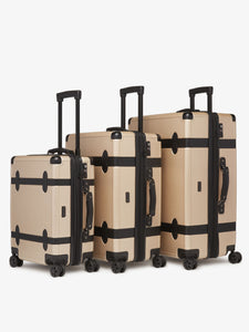 CALPAK TRNK 20 inch beige nude carry on spinner with 4 wheels in vintage trunk style as a part of TRNK luggage collection