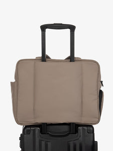 brown CALPAK Luka duffle bag with luggage trolley sleeve
