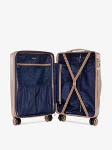 rose gold CALPAK Ambeur hard shell carry on luggage with compression straps
