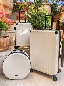 large 30 inch white CALPAK Ambeur lightweight spinner luggage