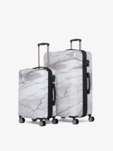 2 piece CALPAK Astyll white marble luggage set that includes carry on and large suitcase