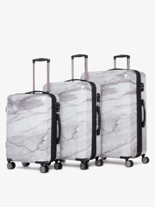 3 piece CALPAK Astyll hard shell white marble luggage set with built in TSA locks