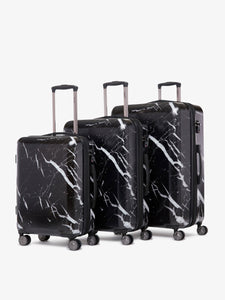 CALPAK Astyll black marble hard shell rolling carry on suitcase as a part of 3 piece luggage set