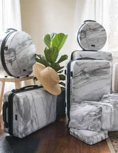medium size 25 inch white marble hard shell spinner luggage as part of CALPAK Astyll collection