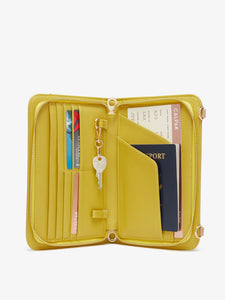 yellow interior of beige sand faux crocodile leather CALPAK travel wallet with RFID blocker