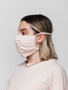 reusable washable pink face mask by CALPAK - modelled - profile